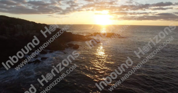 Sunrise with Waves Breaking Gently on Rocky Coast - Shores at Cape Neddick Lighthouse, Maine, USA