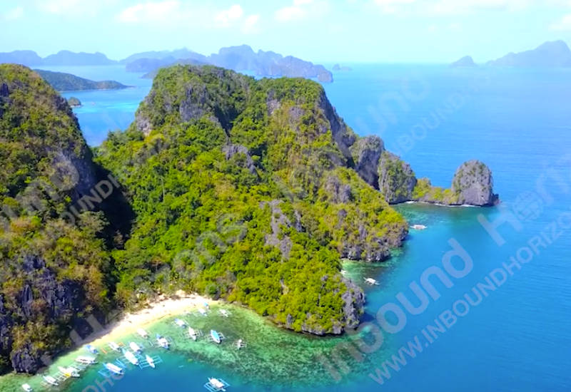 Exotic Beach Cove With Catamaran Style Boats On Rocky Tropical Island El Nido Palawan Philippines Aerial View