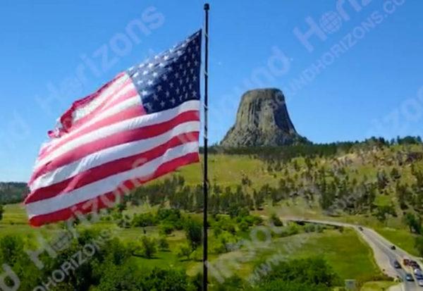 Wyoming-4K-009-AmericanFlagAtDevilsTower